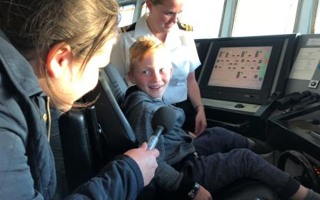 interviewing boy in cockpit